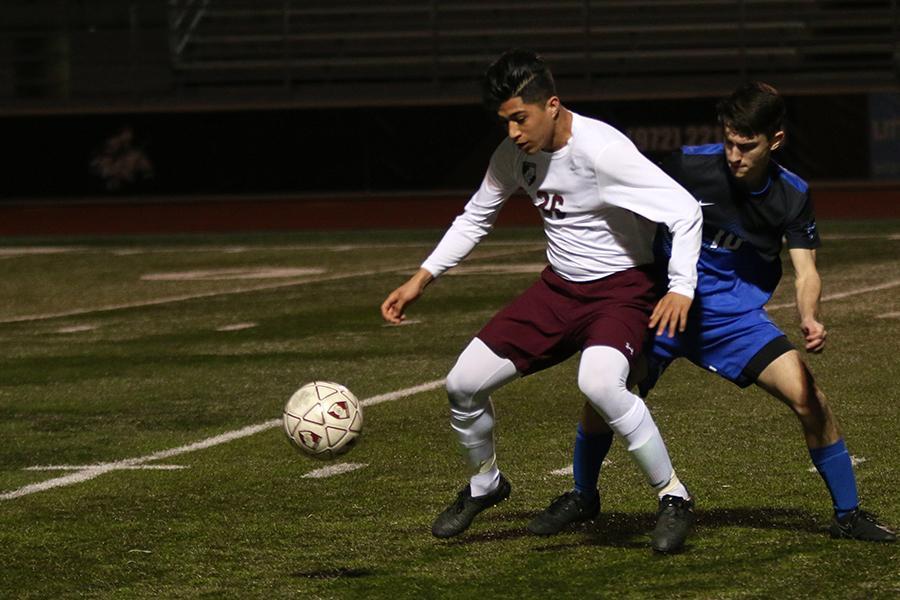 Senior varsity soccer player Jason Pardo (26) blocks the Byron Nelson player during the game on Friday, March 3.
