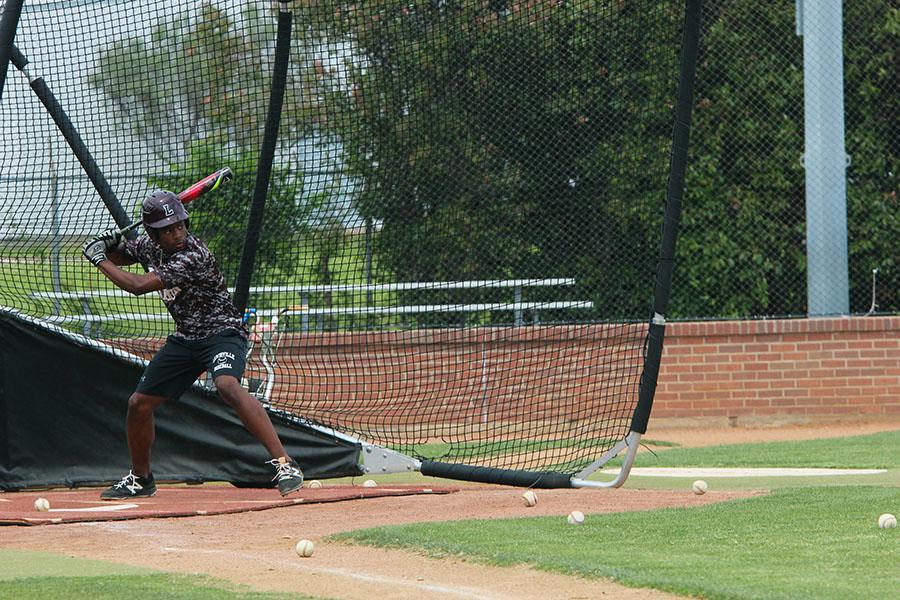 Senior+Patrick+Bethea+practices+batting+during+fourth+period+on+Tuesday%2C+April+25.