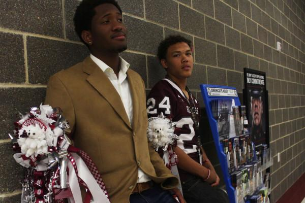 Juniors+Jamir+Carr+and+George+Haskins+wears+their+garters+on+Homecoming+day.