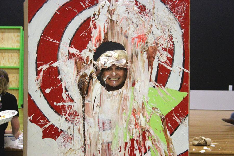 History teacher Bessie Alexander awaits a pie in the face on May 22.