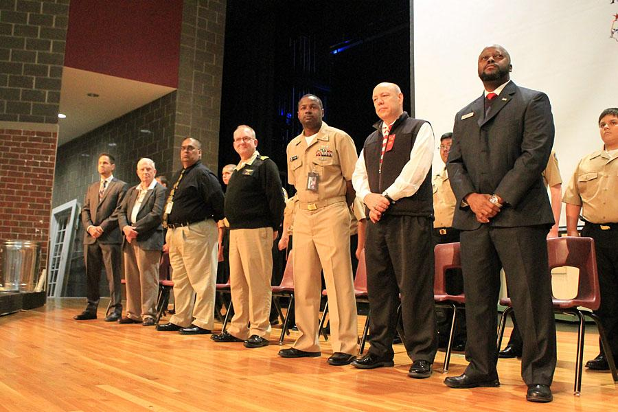 Lewisville High's veterans: [from left] social studies teacher Charles Andrews, substitute Gene Britain, social studies teacher Joe Daniel, ROTC teacher Commander Bob Stuart, ROTC teacher Chief Petty Officer Kenneth Wright, math teacher Frank Scaparra and assistant principal Lanele Lindsey.