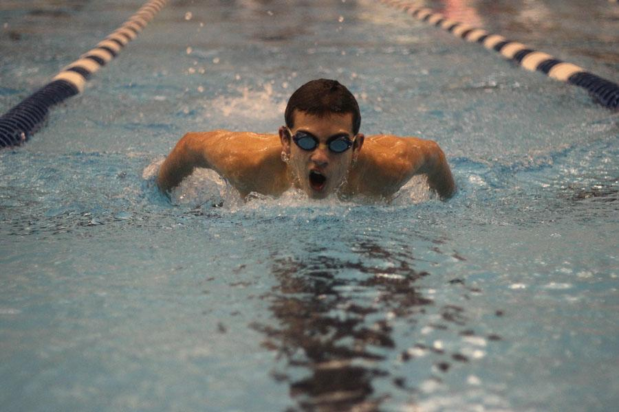 Sophomore Charlie Estrada competes in the butterfly on Dec. 4 against Richardson.