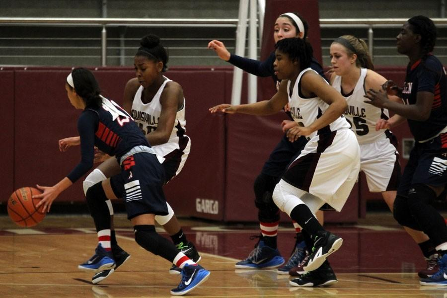 Freshman Kennedy Lankford (40), sophomore Jakeiya Morgan (42), and junior Rebecca Huddleston (25) attempt to get the ball back from Allen on Jan. 23.