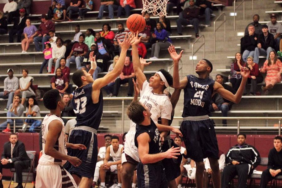 Senior Anthony Davis (40) attempts to tip the ball into the basket against Flower Mound.