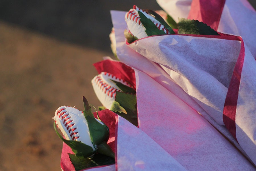 Roses made from baseballs for seniors to give to their mothers on senior night.