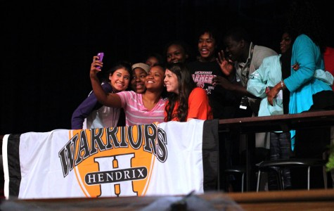 Basketball forward Alex Shumway takes a selfie with friends after signing to Hendrix College.
