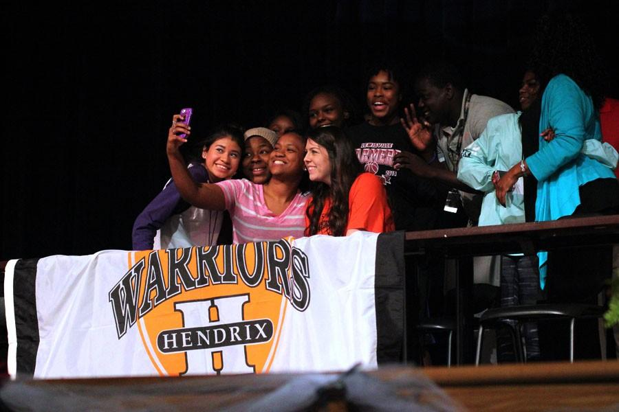 Basketball+forward+Alex+Shumway+takes+a+selfie+with+friends+after+signing+to+Hendrix+College.