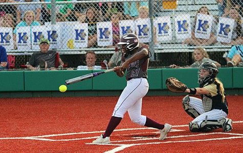 A'leecia Bell (27) connects with a pitch during game 2 against Keller on Friday night at Argyle High School. The Farmers lost the game, but won game 3 on Saturday, 10-3, to return to the state tournament.