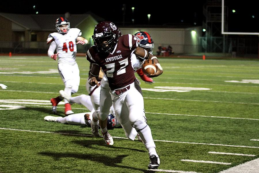 Junior Kwame Mickles (22) rushes for a first down on the home side of the field.