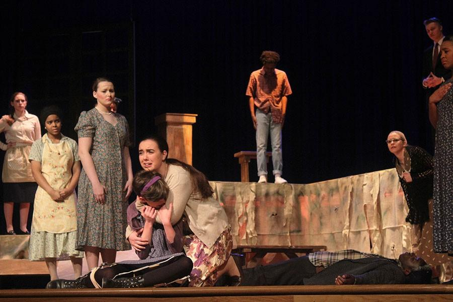 Evelyn Jackson, played by senior McKenzie Cloud, holds her crying daughter Eva Jackson, played by senior Ashlyn Eperjesi.