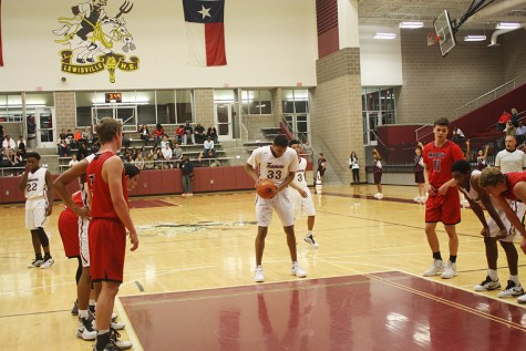Senior Trenton Sandier (33) attempts his second free throw of the night.