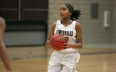 Freshman Anessa Boyd (12) stops to take  a shot during the game against Hebron on Jan. 19.