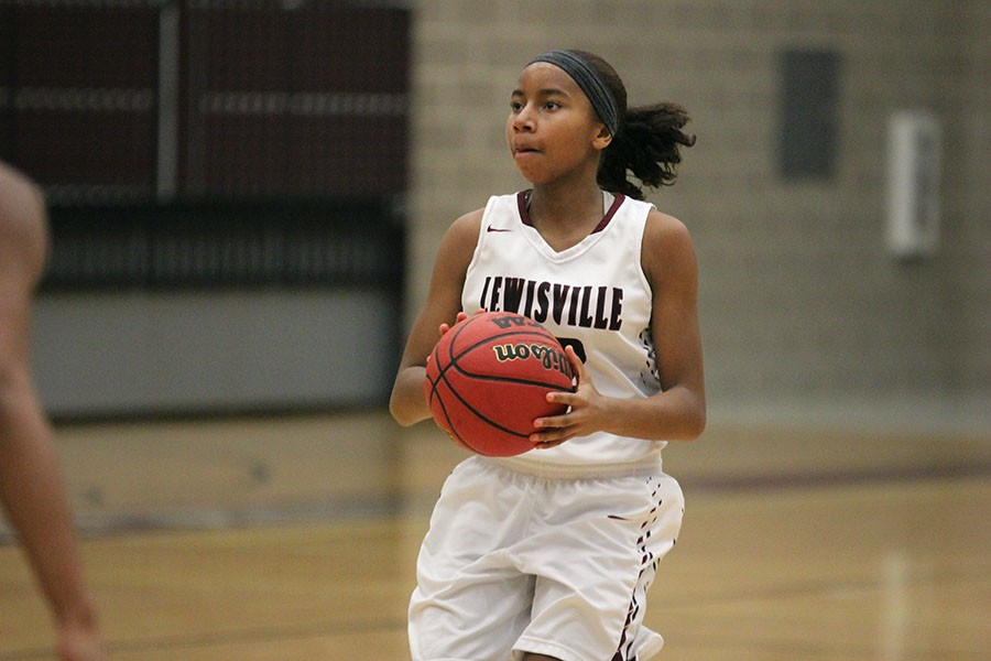 Freshman+Anessa+Boyd+%2812%29+stops+to+take++a+shot+during+the+game+against+Hebron+on+Jan.+19.