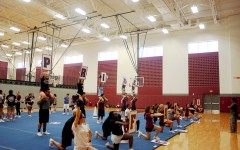 Coed cheer members practice on Jan. 7 for their upcoming competition.