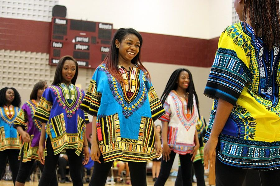 The Harmon African Dancers proudly exhibit their cultural fashion.