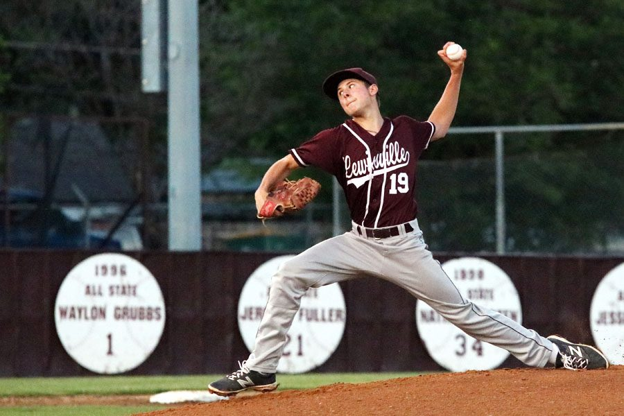 Starting pitcher junior Angelo Gennari pitches the ball to be hit by a Plano batter.