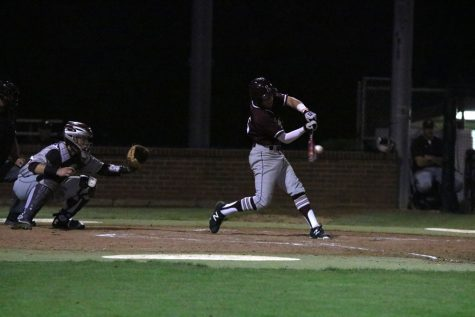 Junior Mason Holt swings at the ball during the home game on April 22 against Plano.