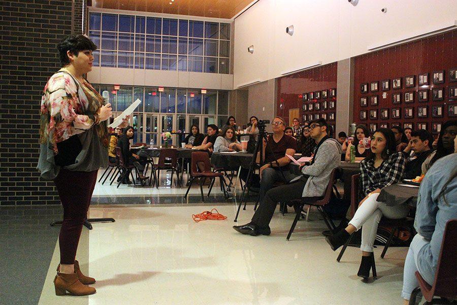 Senior Gabrielle Trinidad recites her poem,