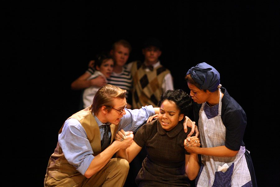 Atticus, played by senior Tallon Coxe, and Calpurnia, played by senior Destinee Gines, try to comfort Helen Robinson, played by junior Eboni Rodgers, when receiving the news of Tom Robinson's death.