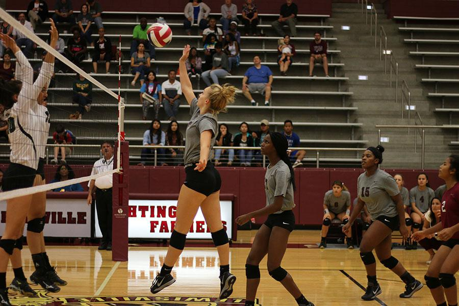 Junior Meredith Wagley spikes the ball during the home game against Lake Dallas on Friday, Sept. 2.