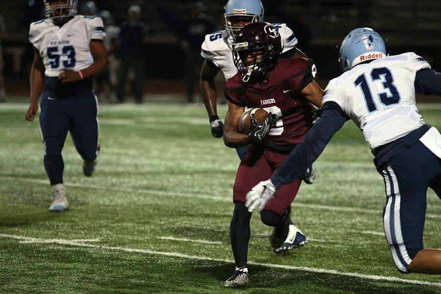 Senior defensive back Kyle Smith (8) runs the ball while being pursued by L.D. Bell players.