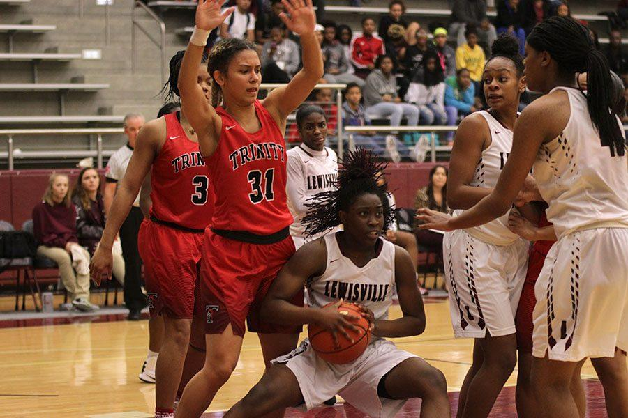 Sophomore Nala Hemingway (15) shields the ball from the defenders.
