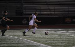 Senior Myah Buhler (5) takes off down the field during the game against Reedy High School on Tuesday, Jan. 10.
