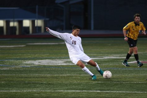 Senior Jason Granados (15) aims toward the goal during the Keller Central game on Friday, Jan. 20.