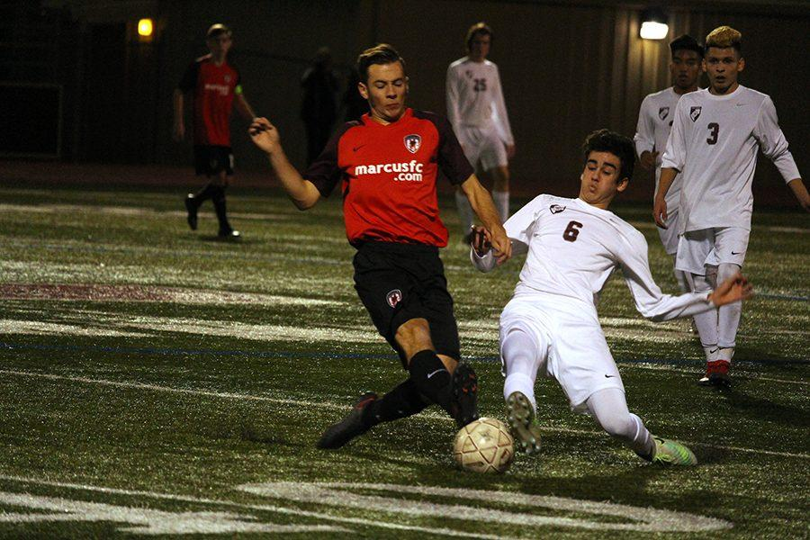 Junior Josue Romo (6) lunges in for the tackle.
