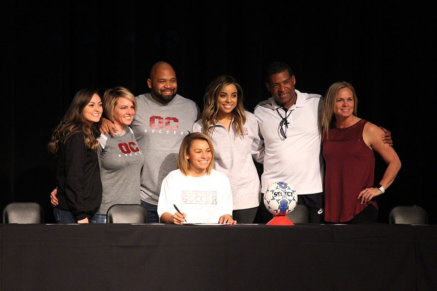 Myah Buhler poses with her family and coach after signing to Oklahoma Christian University for soccer.