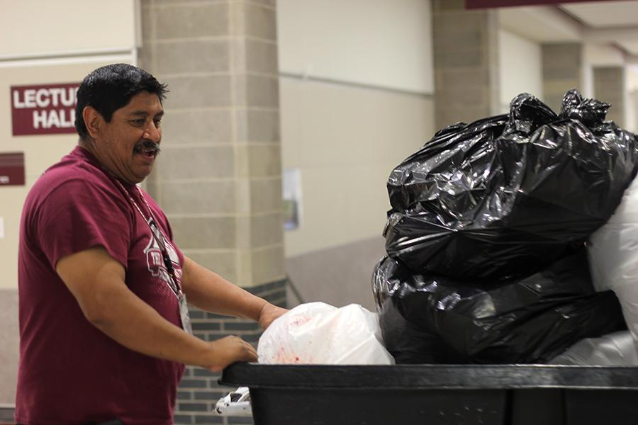 Lead custodian Joe Salas cleans up after lunch on Wednesday, April 19.