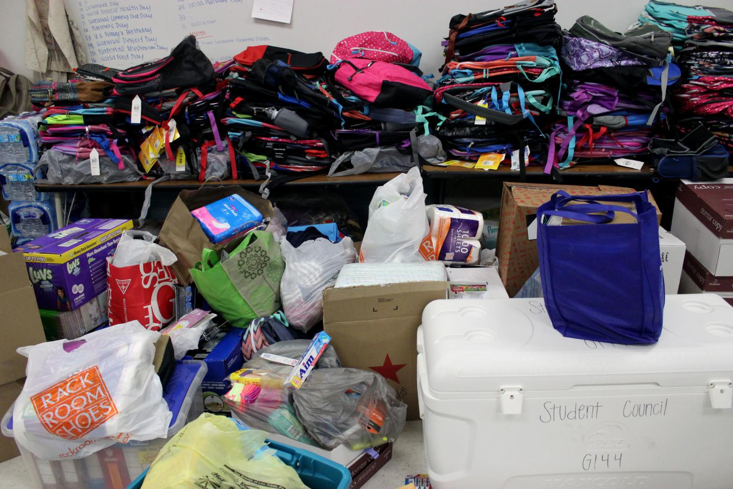 Supplies+and+toiletries+that+students%2C+staff+and+faculty+have+collected+sit+in+the+StuCo+room.++