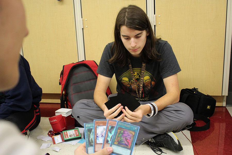 Senior Simon Duncan competes in a Yu-Gi-Oh! placement tournament during lunch on Thursday, March 1.