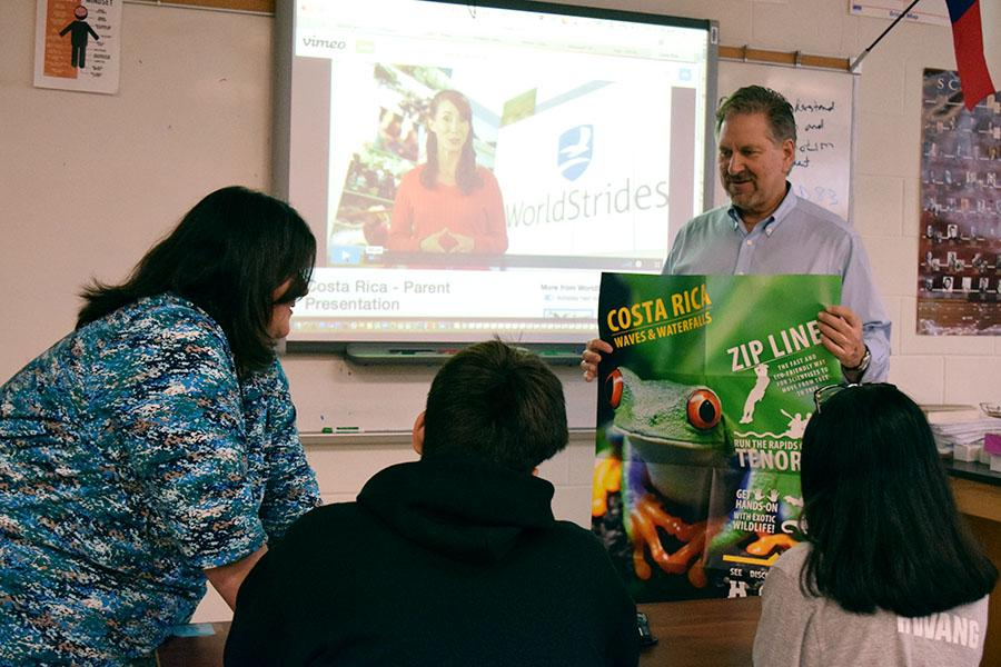Physics teacher David Pribich speaks to students about Costa Rica during lunch on Thursday, March 1.