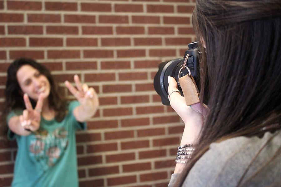 Senior Marissa Alvarez takes photos for a fellow student.