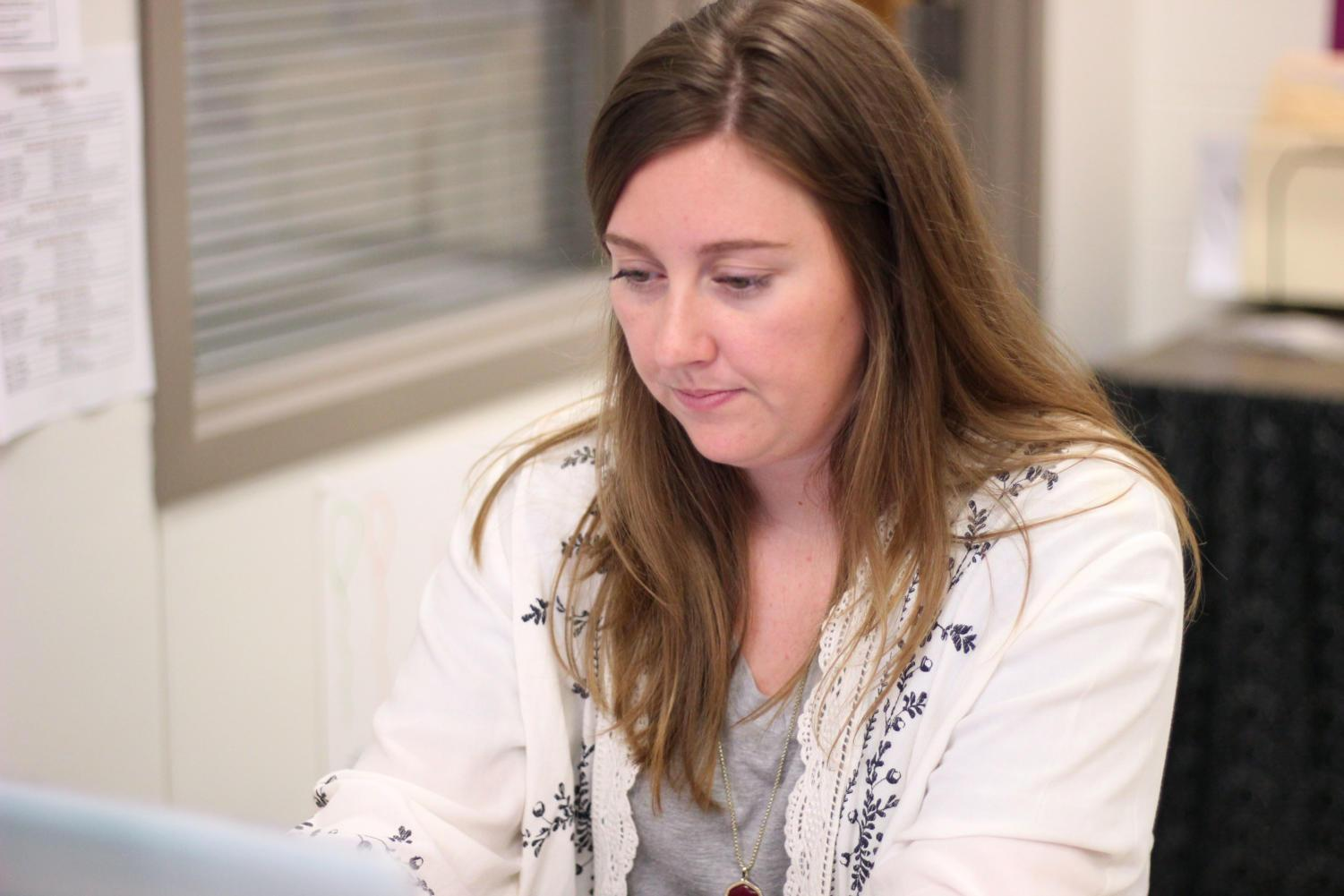 Family consumer science teacher Lauryn Neal works on her class schedule for the week of April 30.
