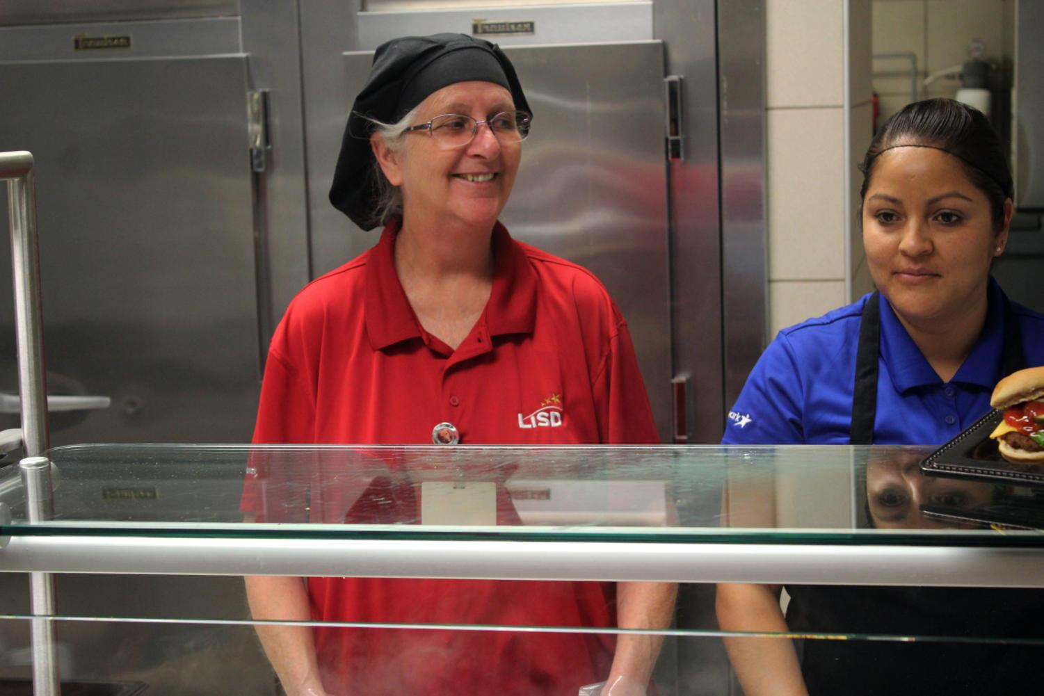 Head cafeteria worker Penny Potter enjoys happy students coming through the lines.