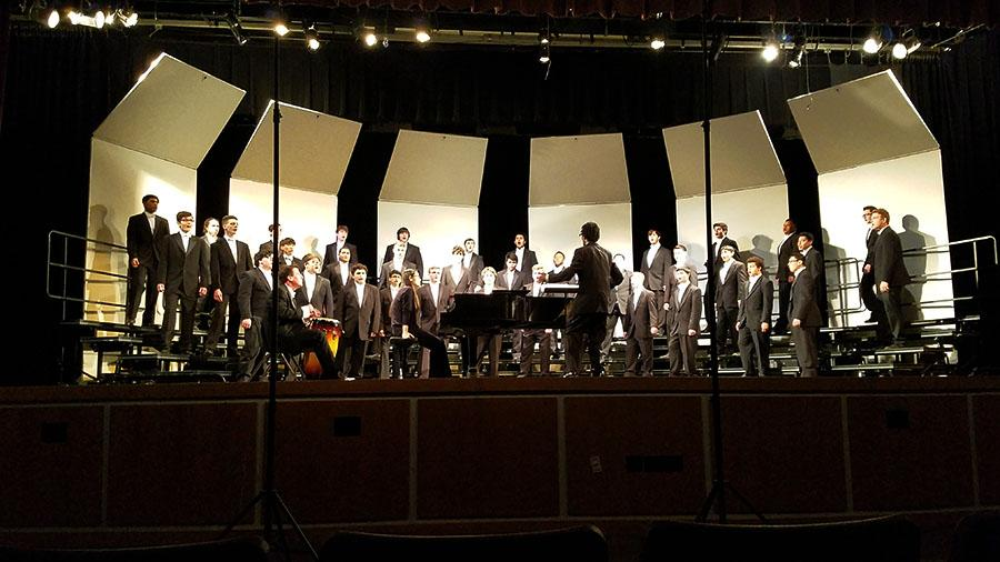 Senior Jay Teamer directs the men's choir. Courtesy of Kimberly Teamer.
