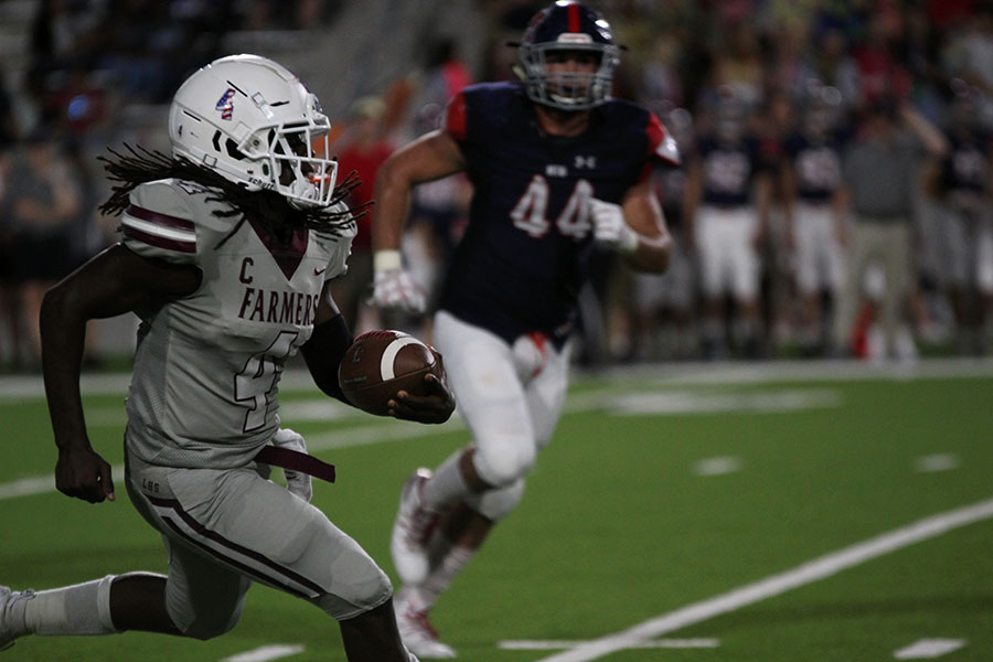 Senior AJ Newsome (4) runs the ball during the away game at McKinney Boyd.