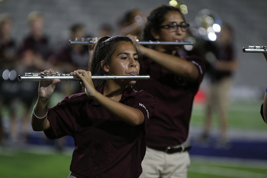 Junior Brianna Guerra plays her flute during the halftime show at the football game against McKinney Boyd on Thursday, Sept. 13.