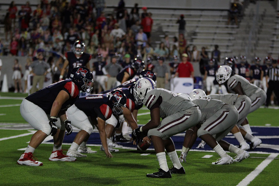 The football team lines up for a defensive play at the away game against McKinney Boyd on Thursday, Sept. 13.