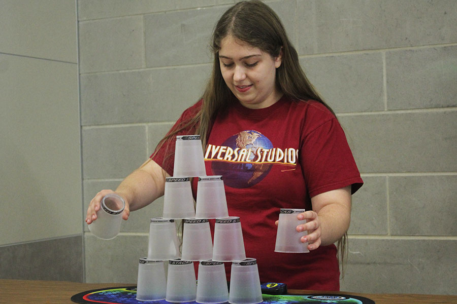 Senior Sarah Raptis begins to stack her cups.
