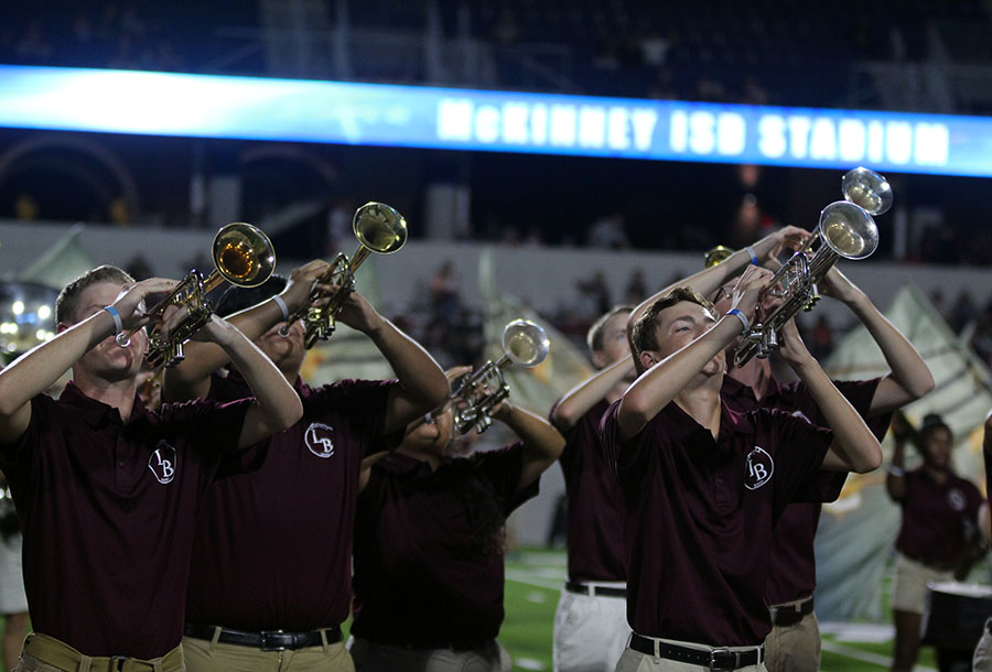 The trumpet section performs the band's halftime show,