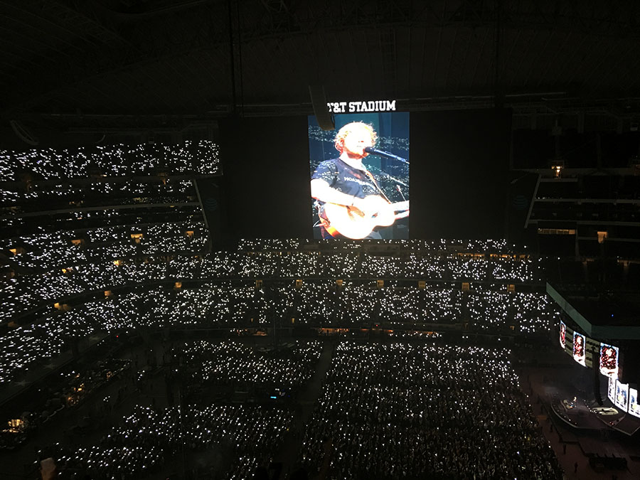 Fans hold up flashlights during Ed Sheeran's performance of