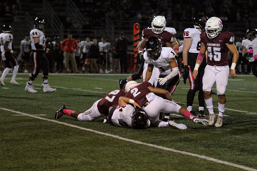 The Farmers tackle a Coppell player during the game on Friday, Oct. 12.