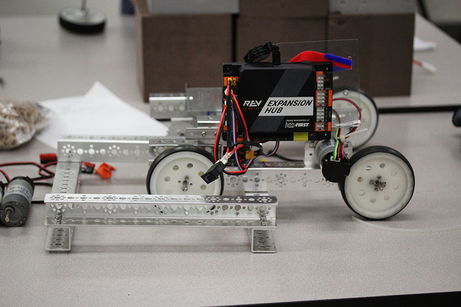 This year's robot rests on a table with spare parts.