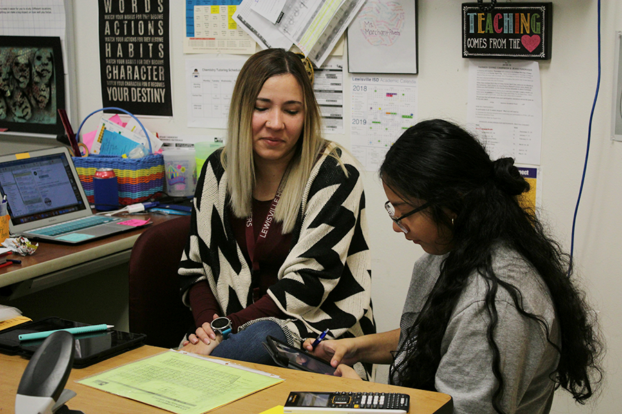 Chemistry teacher Angie Marchany-Rivera tutors a student after school on Tuesday, Nov. 27.