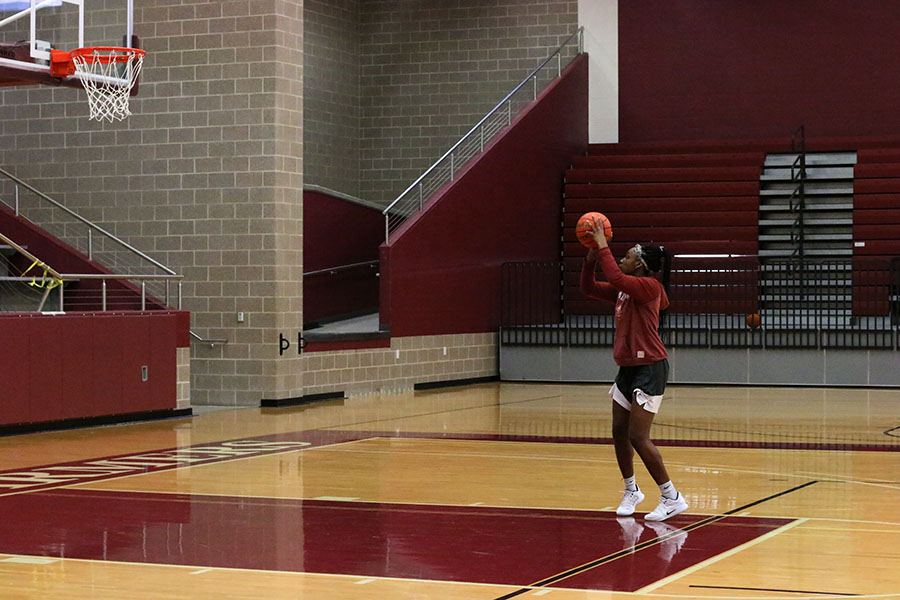 Junior Sydney Savage practices her jumpshot at the top of the paint during morning practice on Wednesday, Nov. 14.