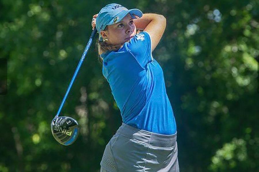 Senior varisty golfer Simone Campise focuses on the ball after swinging the golf club. Courtesy of North Texas Junior PGA.