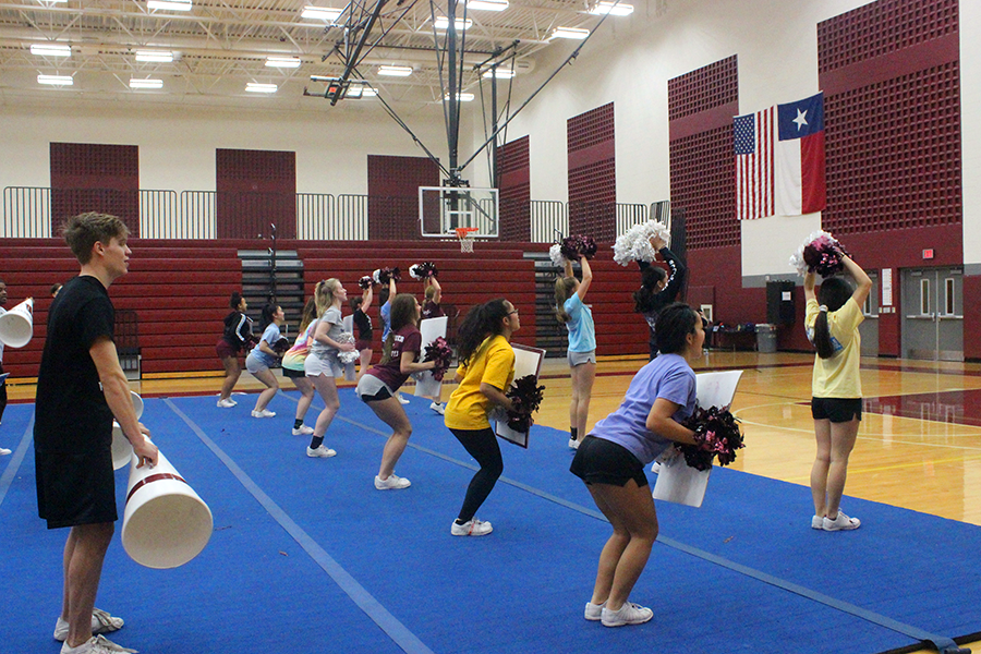 The+varsity+cheer+team+practices+their+routine+for+nationals+during+a+third+period+practice+on+Friday%2C+Jan.+25.